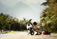 Lady biker with a motobike Royalty Free Stock Photo