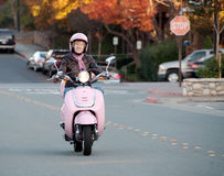 Lady biker on pink scooter Royalty Free Stock Photos