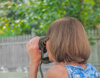 Lady With Binoculars Royalty Free Stock Images