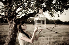 Lady with bird cage Royalty Free Stock Images