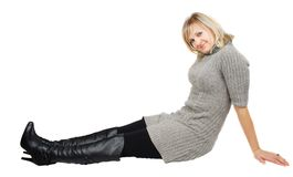 Lady in black boots  and gray dress. Stock Photos