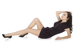 Lady in black dress lying isolated white Stock Images