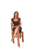 Lady in black dress sitting Stock Images