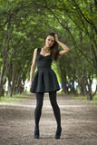 Lady in black dress in summer park Royalty Free Stock Photos