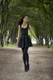 Lady in black dress in summer park Stock Photos