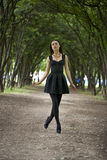 Lady in black dress in summer park Royalty Free Stock Images