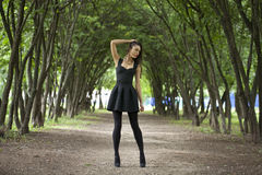 Lady in black dress in summer park Stock Photo