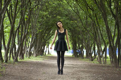 Lady in black dress in summer park Royalty Free Stock Photo