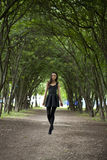 Lady in black dress in summer park Stock Image