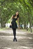 Lady in black dress in summer park Stock Photography