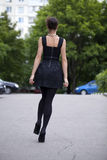 Lady in black dress in summer street Stock Image