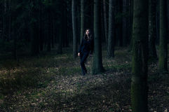 Lady in black in the forest Stock Photo