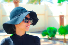 The Lady with the Black hat Laughing and having fun under the sun Royalty Free Stock Photos