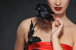 Lady with black rose Royalty Free Stock Image