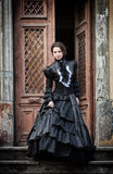 Lady in black standing in the doorway Royalty Free Stock Photography