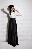 Lady in black and white. Portrait of a beautiful girl in a white blouse and black skirt Royalty Free Stock Photo