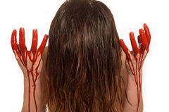 Lady with blood pouring down her hands Stock Photo