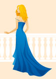 Lady in Blue. Blond lady in blue dress Stock Image