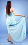 Lady in blue dress Stock Photo