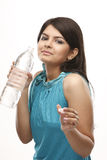 Lady in blue dress drinking water royalty free stock photography