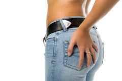 Lady in blue jeans with belt. Isolated over white background Stock Images