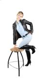Lady in blue jeans staying near chear Stock Photo