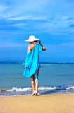 Lady in blue shawl on the beach Royalty Free Stock Image