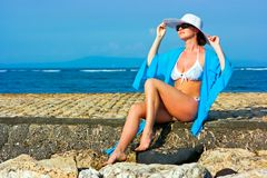 Lady in blue shawl on the beach Royalty Free Stock Photos