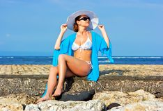 Lady in blue shawl on the beach Stock Photography