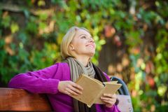 Lady bookworm read book outdoors fall day. Woman reading book. Fall literature top list. Book list for autumn season. Intellectual hobby. Girl sit bench royalty free stock photography