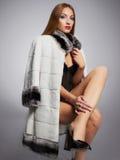 Lady boss in fur. Beautiful young woman lady boss in fur.winter fashion.Beauty Model Girl. Woman in Luxury Fur coat stock photo
