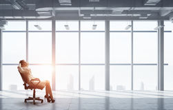 Lady boss in office chair . Mixed media Royalty Free Stock Photo