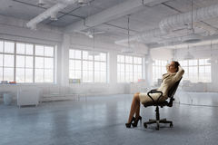 Lady boss in office chair . Mixed media Royalty Free Stock Image