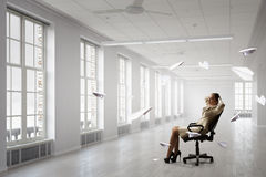 Lady boss in office chair . Mixed media Royalty Free Stock Photos