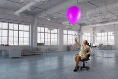 Lady boss in office chair . Mixed media Stock Photo