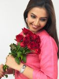 Lady with a bouquet of red roses Stock Photos