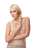Lady with braid. Portrait of a young lady with a braid isolated on white background Stock Photo
