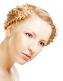 Lady with a braid isolated on white. Portrait of a young lady with a braid isolated on white Royalty Free Stock Images