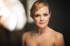 Lady with braid. Portrait of a young lady with a braid in photostudio interior Royalty Free Stock Photos