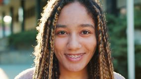 Lady with Braids. Emotion. Smile. Closeup shot stock video