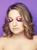 Lady with bright makeup. Photo of young lady with bright makeup on bright background Stock Photography