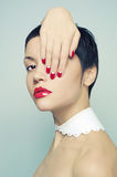 Lady with bright nail polish Stock Image