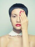 Lady with bright nail polish Stock Image