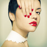 Lady with bright nail polish Stock Photography