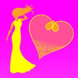 Lady in a bright summer dress and frame in the shape of a heart.  Royalty Free Stock Image