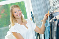 Lady browsing in clothes shop Royalty Free Stock Photos