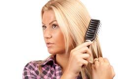 Lady brushing her hair Stock Image