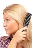Lady brushing her hair Royalty Free Stock Images