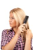 Lady brushing her hair Royalty Free Stock Photo