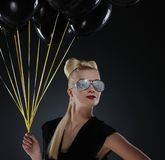 Lady with a bunch of black balloons Stock Photo